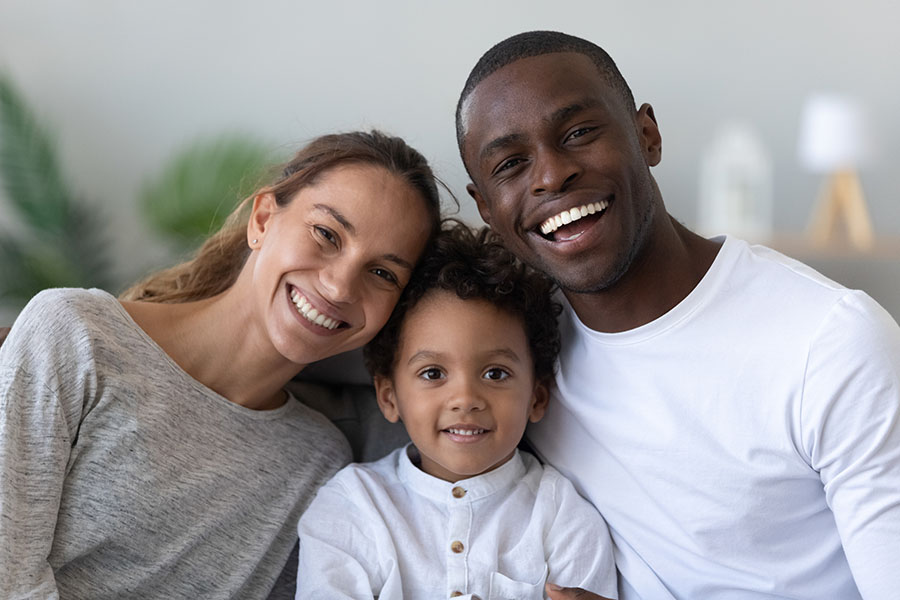 Client Center - Portrait Of Smiling Family At Home